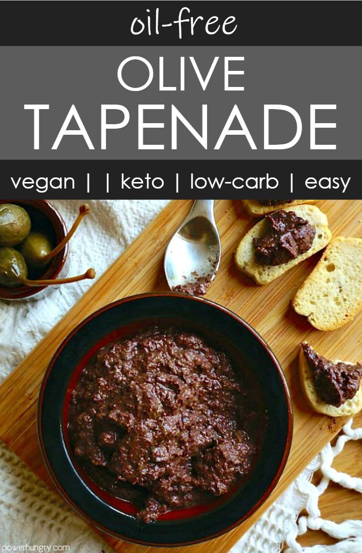 overhead shot of a dark bow l filled with olive tapenade, with a small bowl of capers, and a spoon alongside