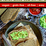 overhead shot of slices of chickpea flour flax bread with a green pea spread