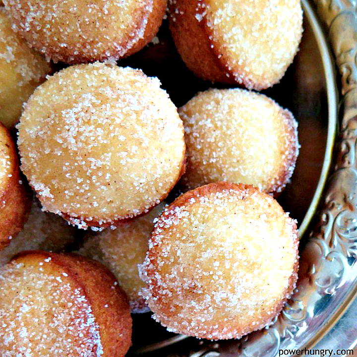 bowl full of mini oat almond donut muffins sprinkled with sugar