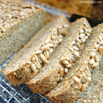 close up of sunflower seed bread on a wire cooling rack