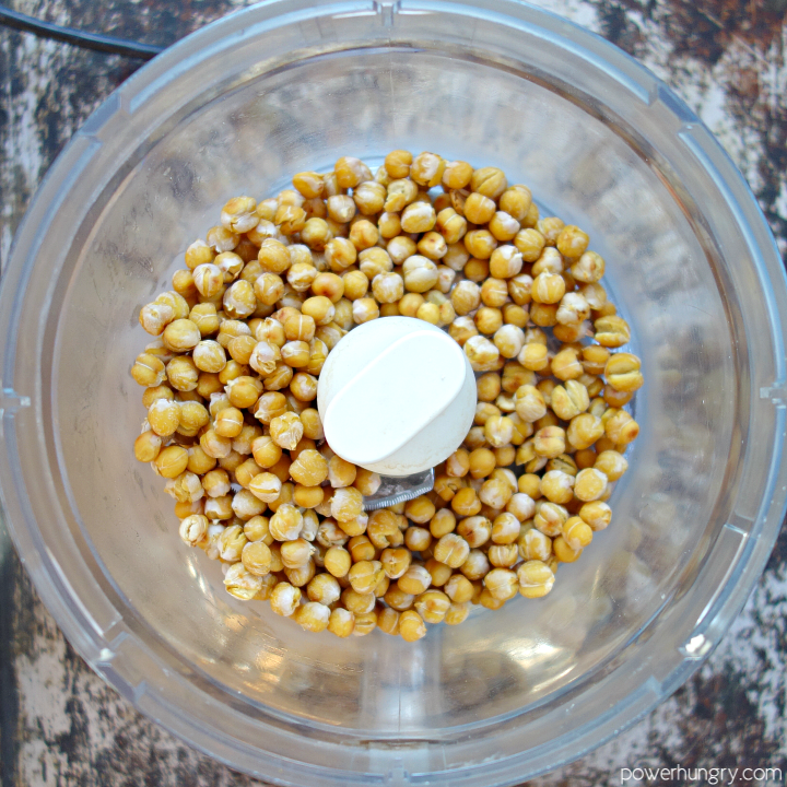 baked chickpeas in a food processor bowl, shortly before being blitzed into crumbs