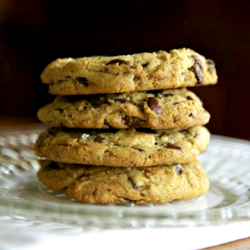 stack of 4 oil-free vegan chocolate chip cookies on a glass plate