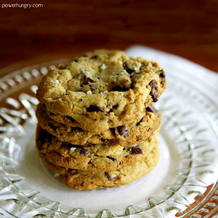 stack of vegan and oil-free chocolate chip cookies on a glass plate with a white napkin underneath