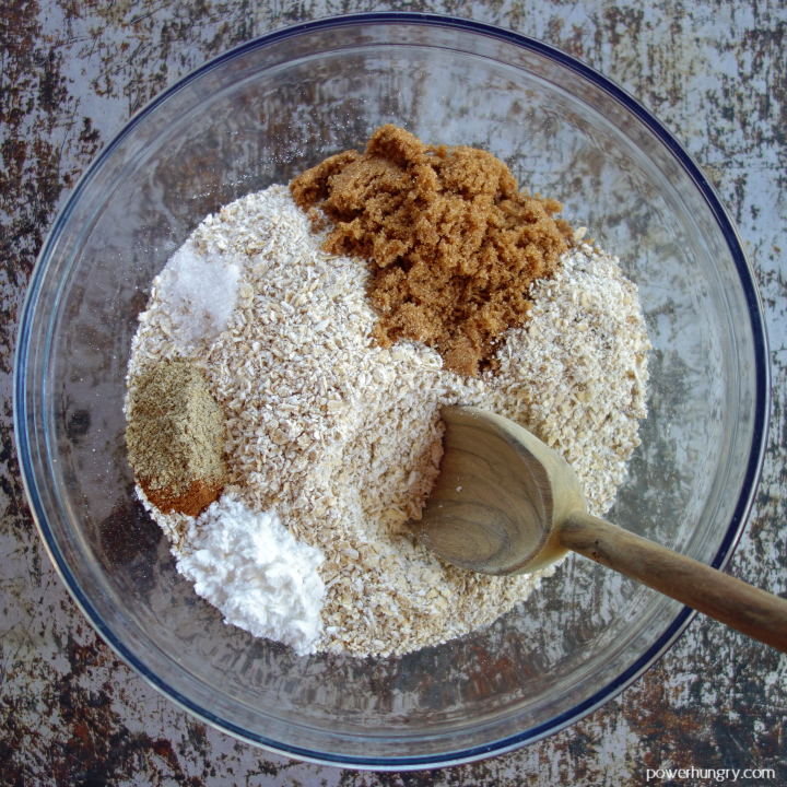 glass bol with the ground oats and other dry ingredients for the thumbprint cookies