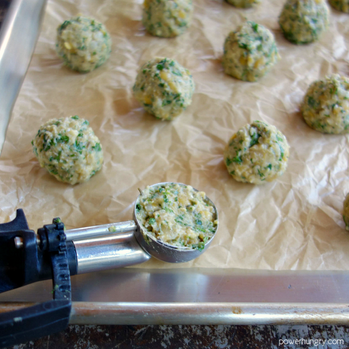 vegan pea meatballs, scooped out and rolled, ready to be baked