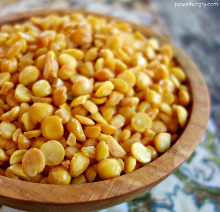 close-up of crispy baked split peas in a wooden bowl