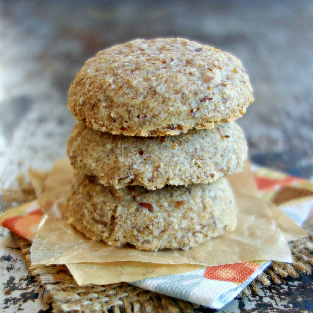 stack of 3 coconut flour cookies on a napkin