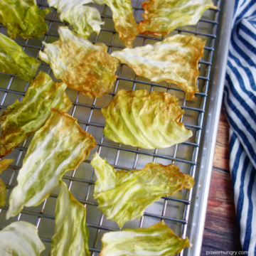 baked cabbage chips on a baking rack
