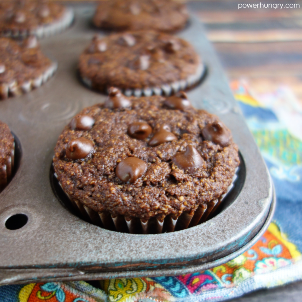 close up of a chocolate almond flour oat muffin in an antique muffin tin