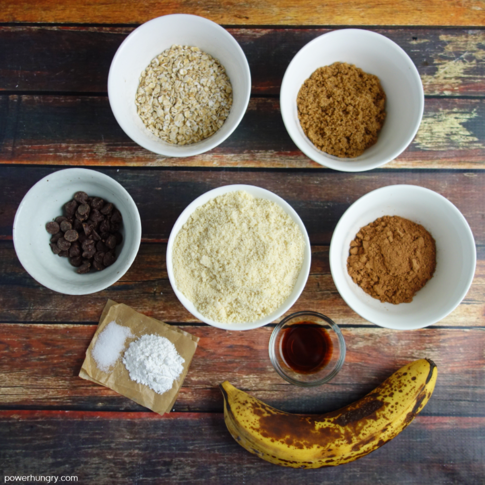 ingredients for healthy chocolate muffins laid out on a wooden background