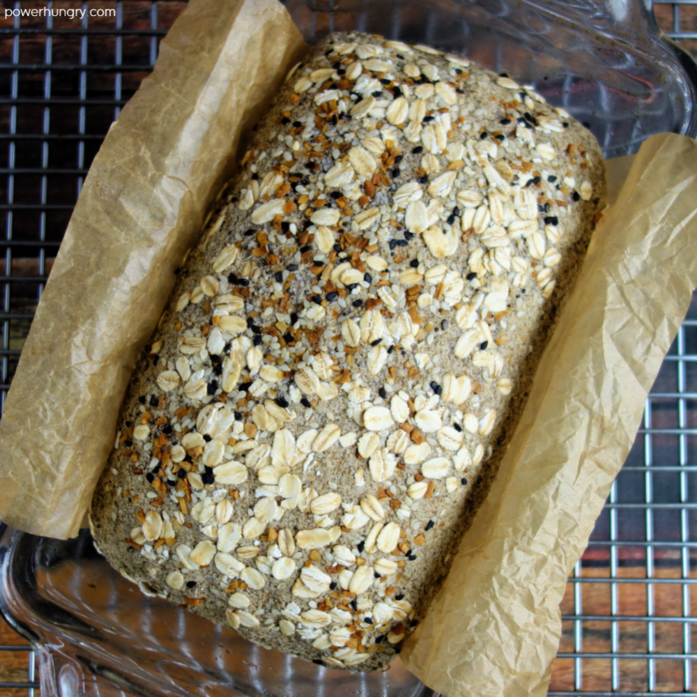 buckwheta bread in a baking pan, cooling on a wire cooling rack
