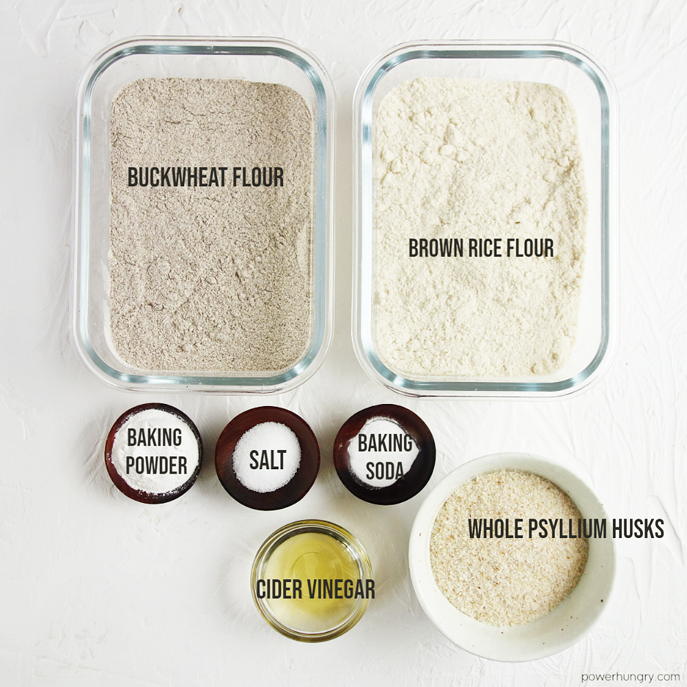 overhead shot of the ingredients to make buckwheat bread, all on a white background
