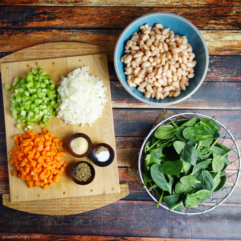 ingredients for white bean soup on a wood board