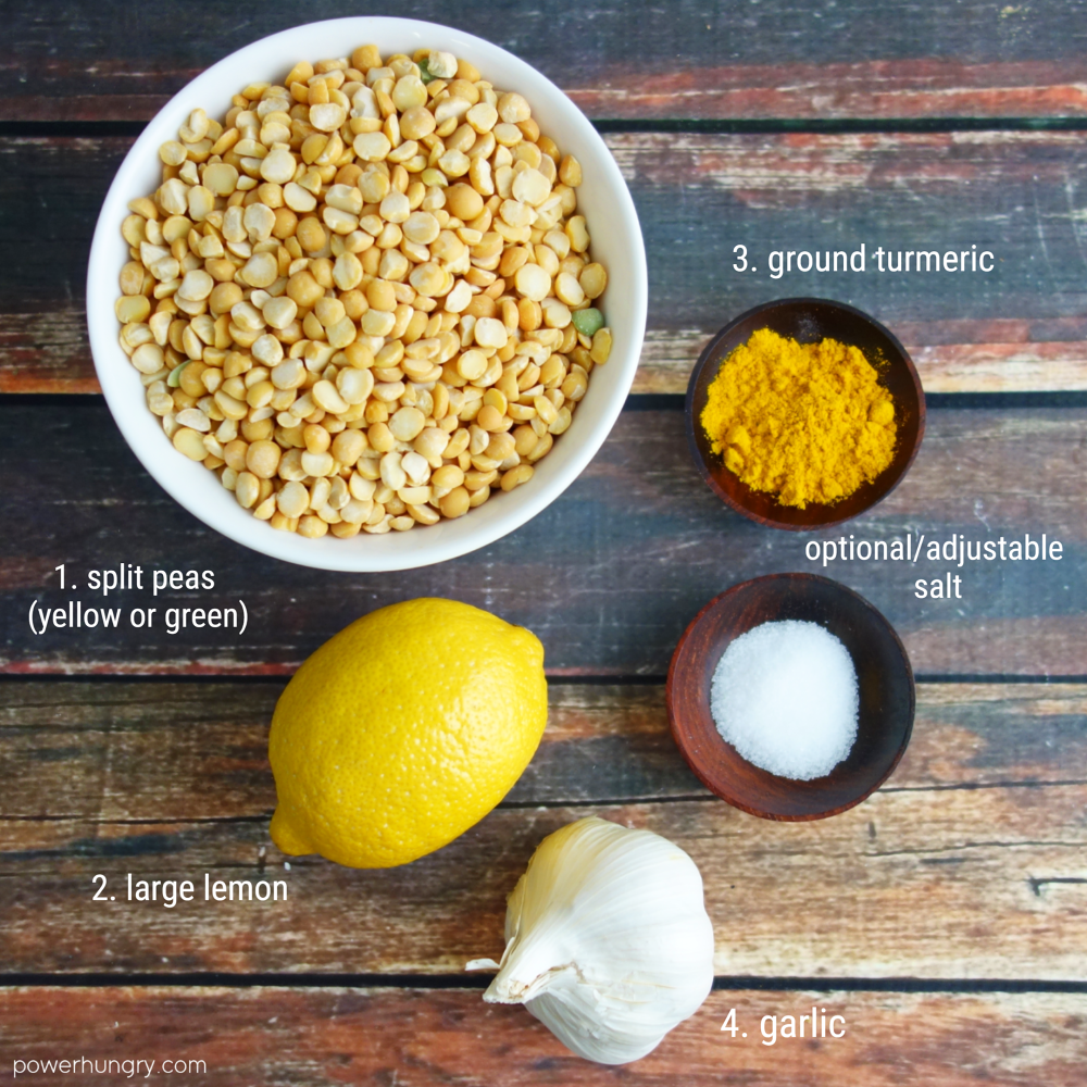 the ingredients for yellow split pea dip on a wooden board