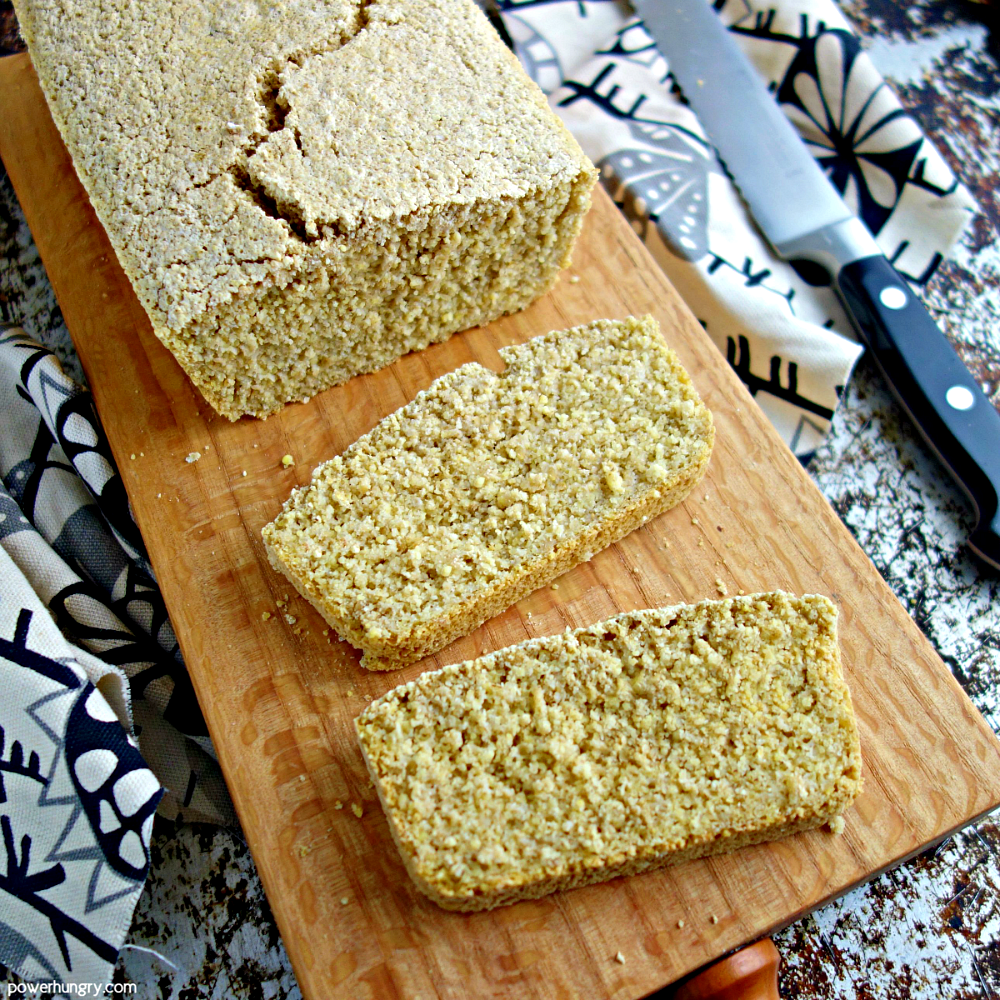 sliced bread made from oats and millet on a wood cutting board