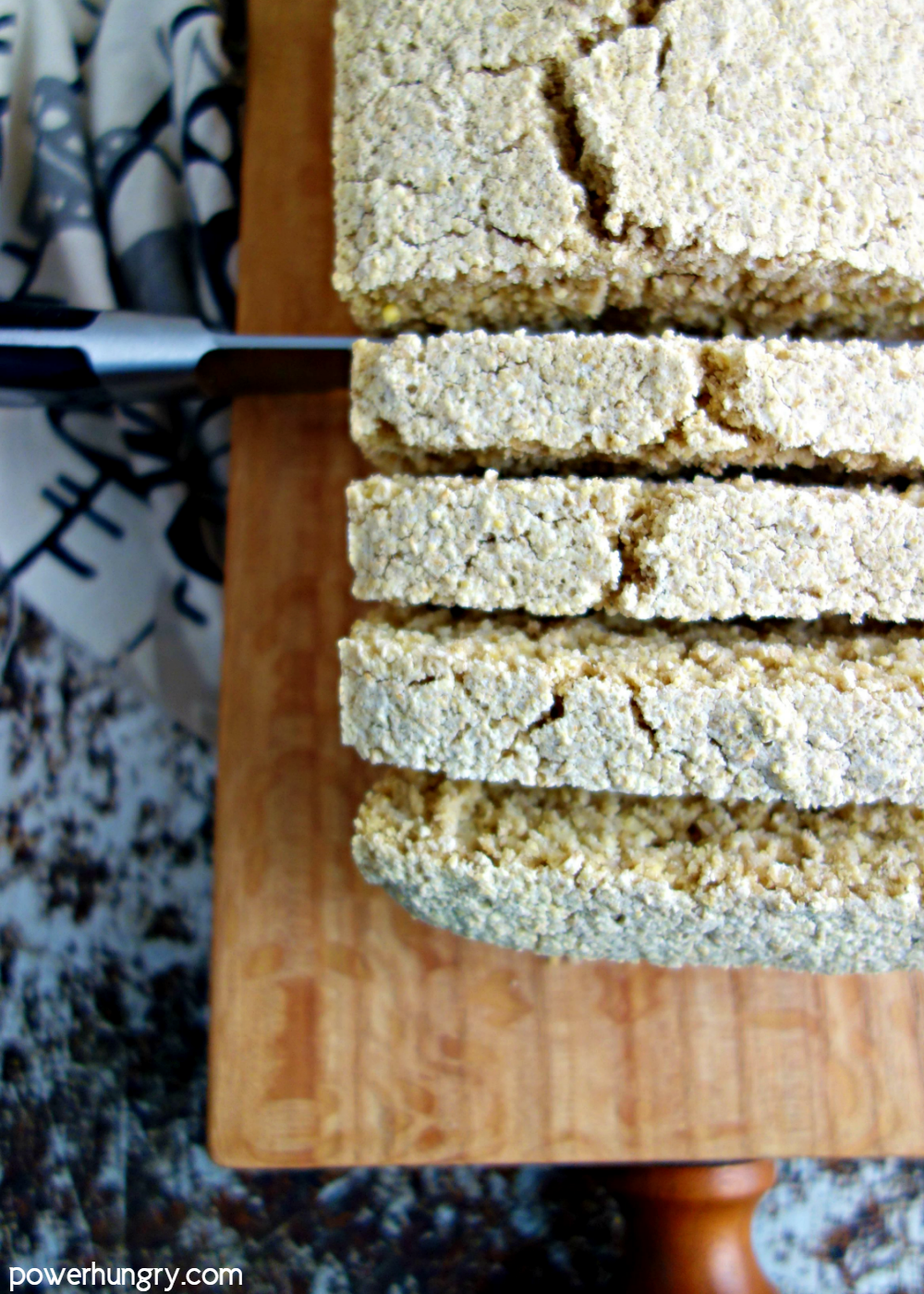 close-up of sliced milet oat bread on a wood cutting board