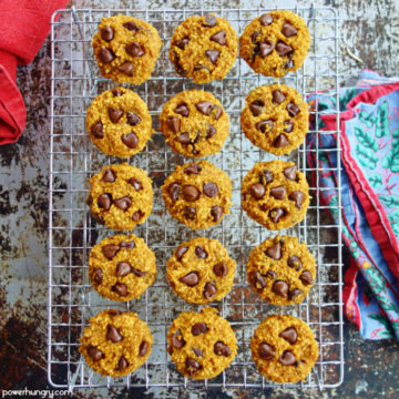 pumpkin oat cookies on a wire cooling rack with a blue and red napkin alongside