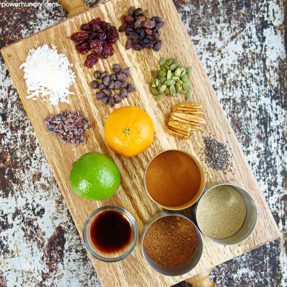 wooden board covered with ingredients for adding to cookies