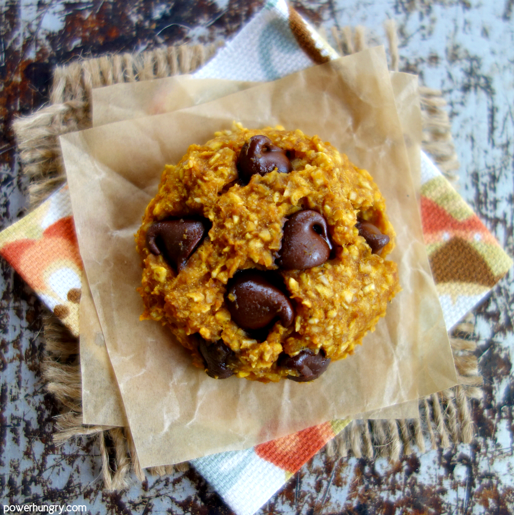 a single pumpkin oat cookie on a floral napkin