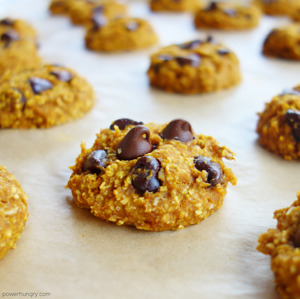 baked pumpkin oat cookies on a parchment paper lined baking sheet