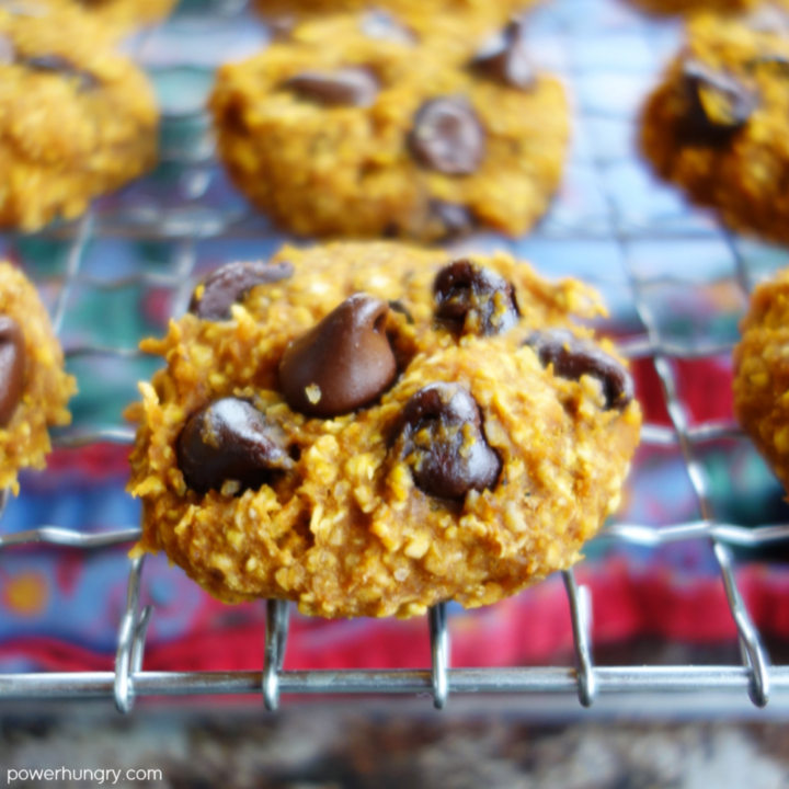 close up of a pumpkin oat cookie on a wire rack