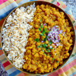 curried split peas in a metal bowl with rice