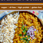 metal bowl filled with easy split pea curry (dal)