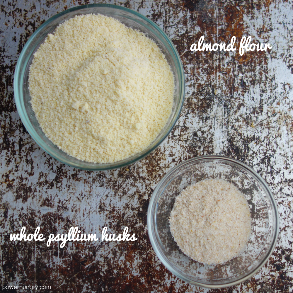 2 glass bowls, one filled with almond flour, one filled with whole psyllium husks