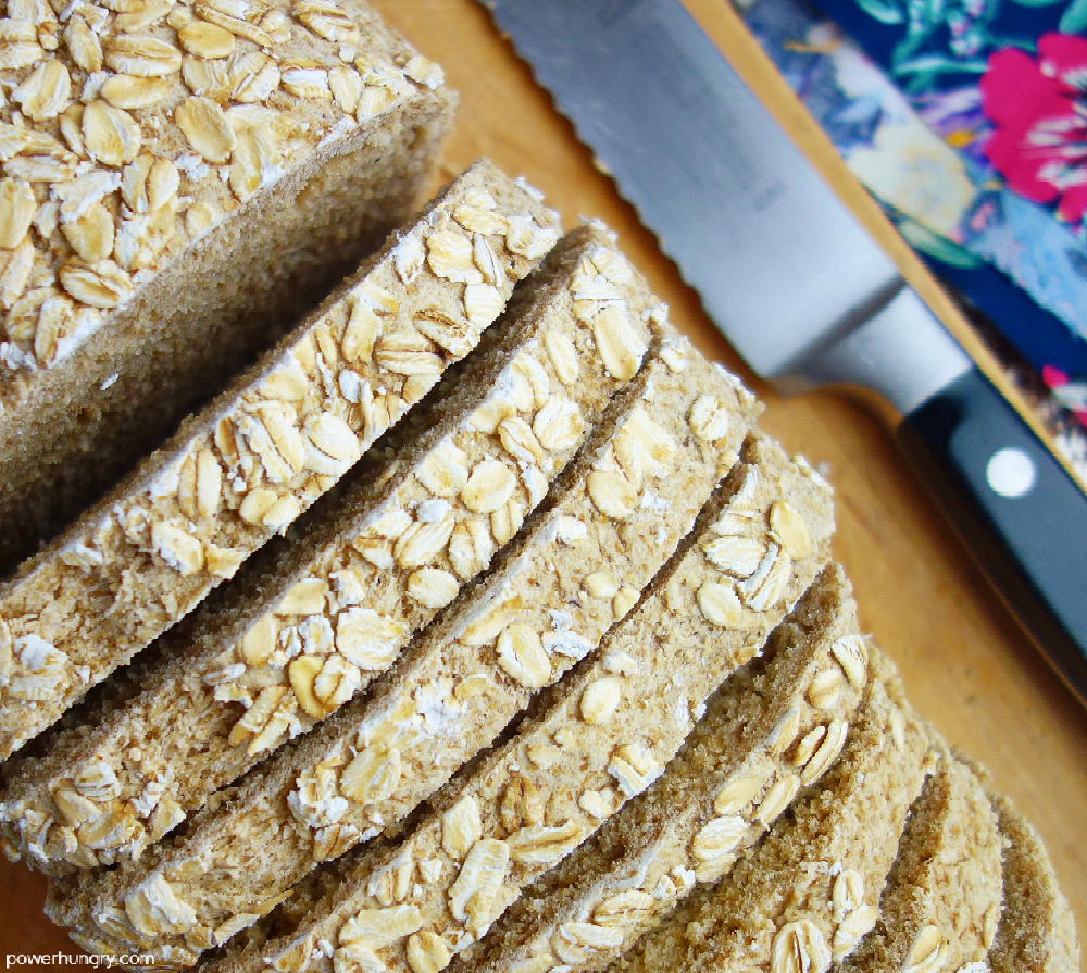 close up of slice oat bread on a wooden board