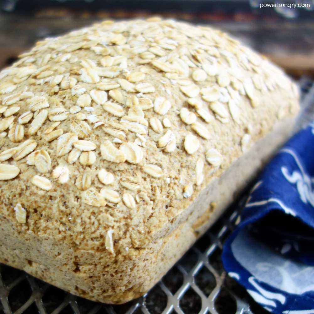 baked oat bread cooling on a wire cooling rack