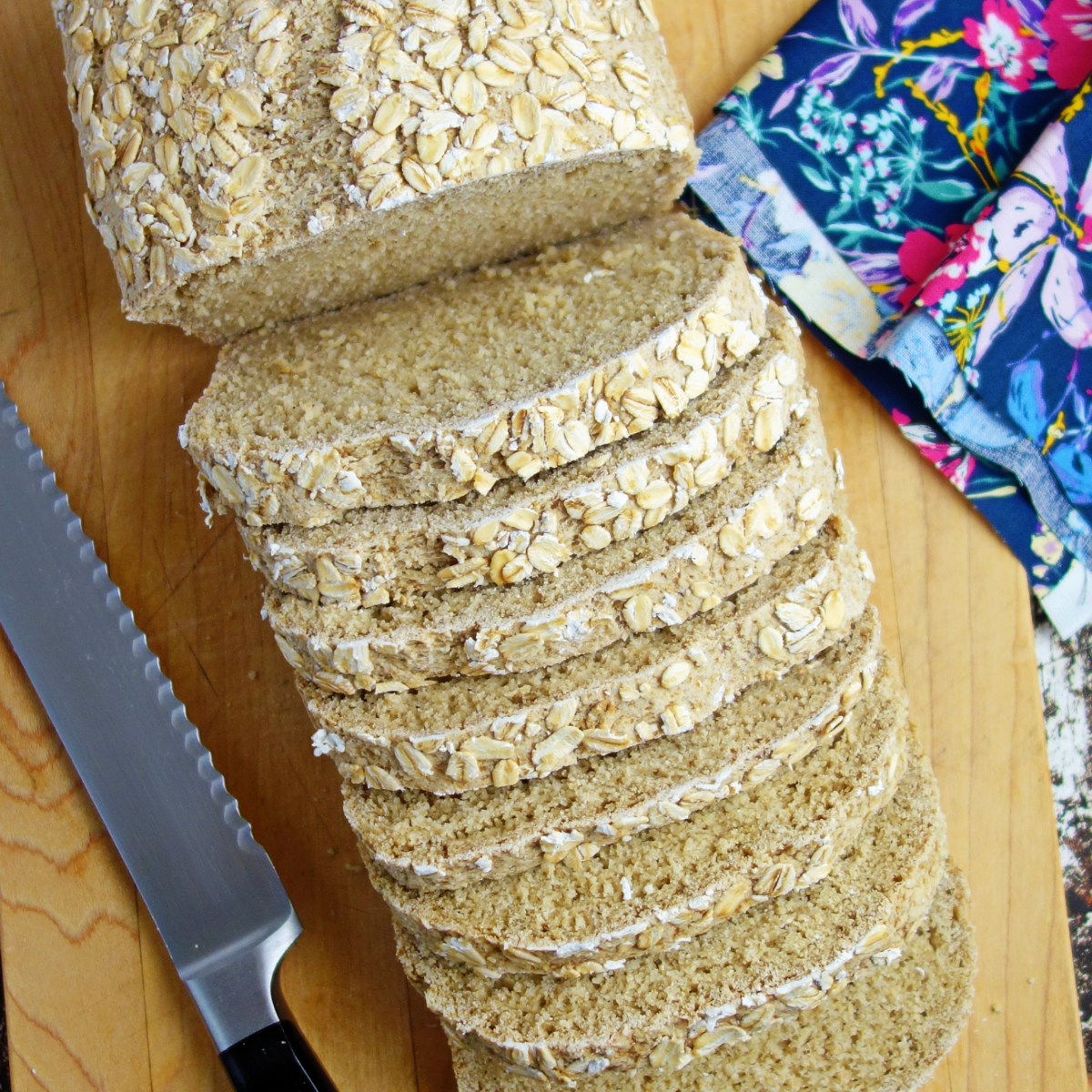 overhead shot of a loaf of oat bread, sliced