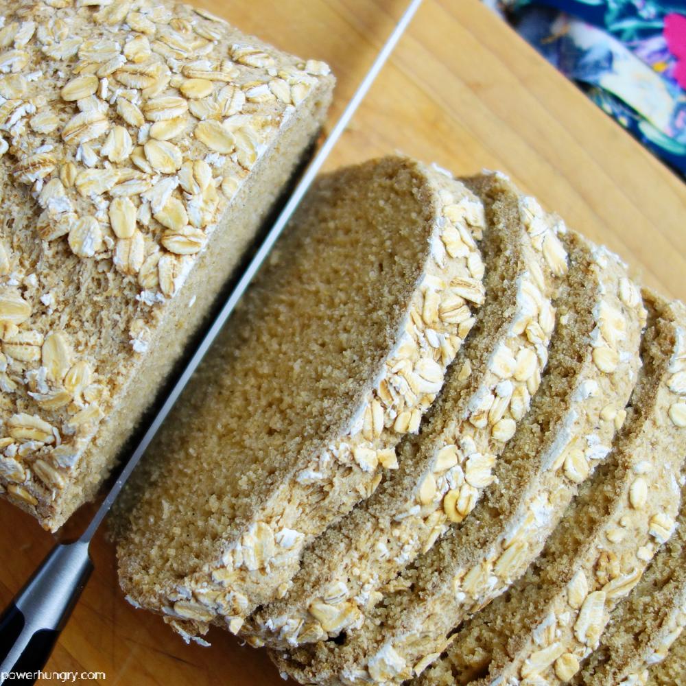 slices of oat sandwich bread on a wood cutting board