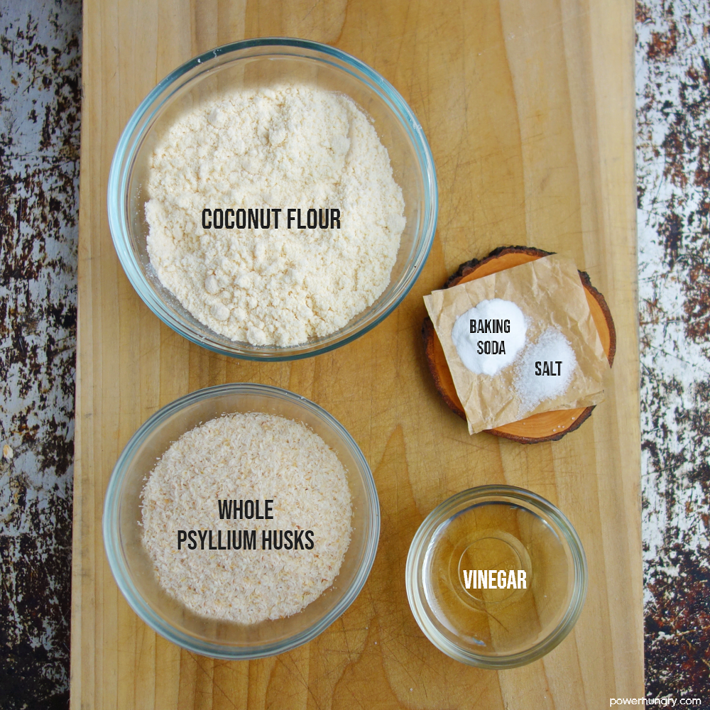 ingredients for coconut bread on a wooden cutting board