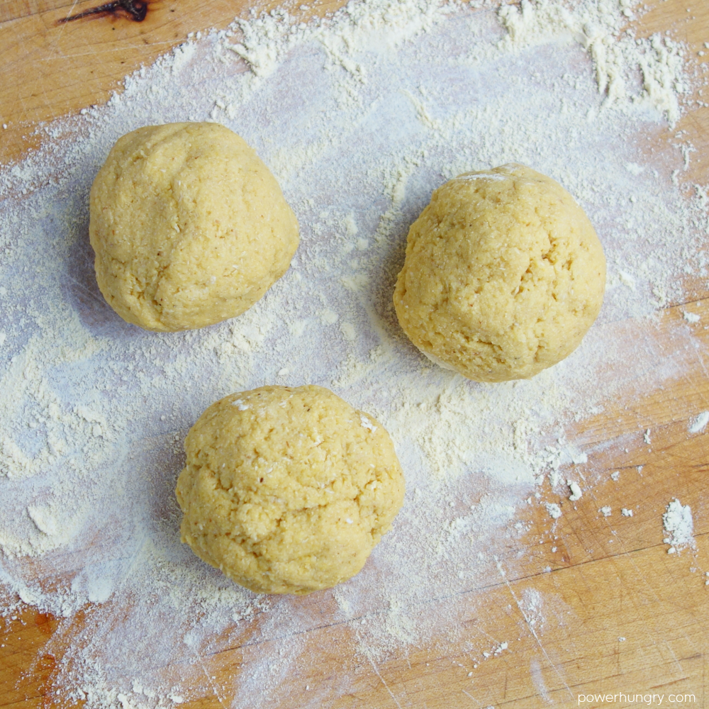 chickpea flour naan dough divided into three equal portions