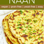 stack of chickpea flour naan on a lace edged white napkin