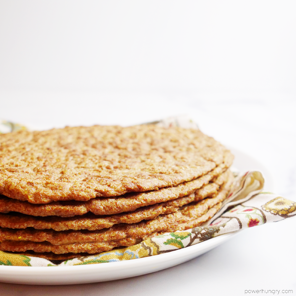 1-ingredient flax tortillas atop a napkin on a white plate