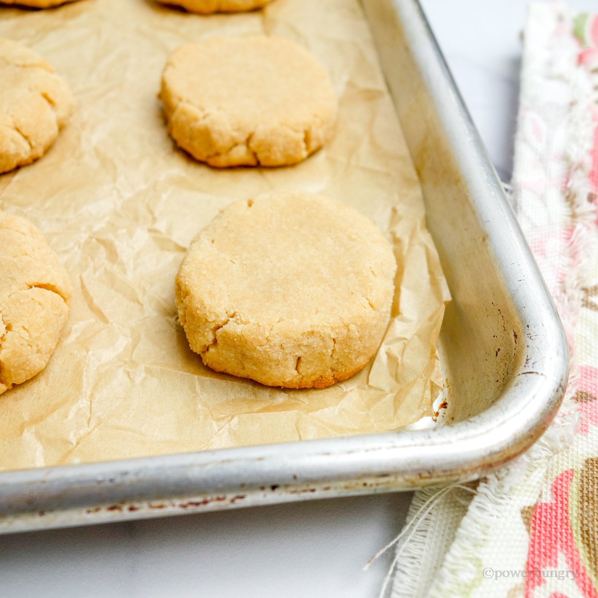 coconut flour cookies on a baking sheet