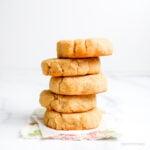 a stack of 5 coconut flour shortbread on a flral napkin