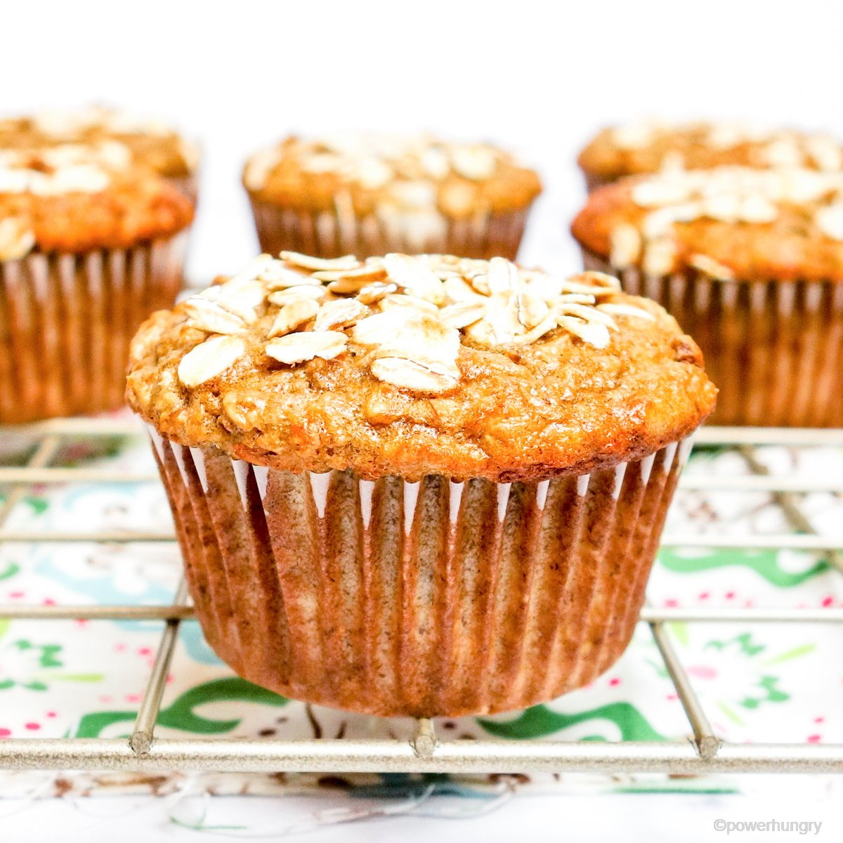 banana oat muffin that is vegan and gluten-free on a cooling rack