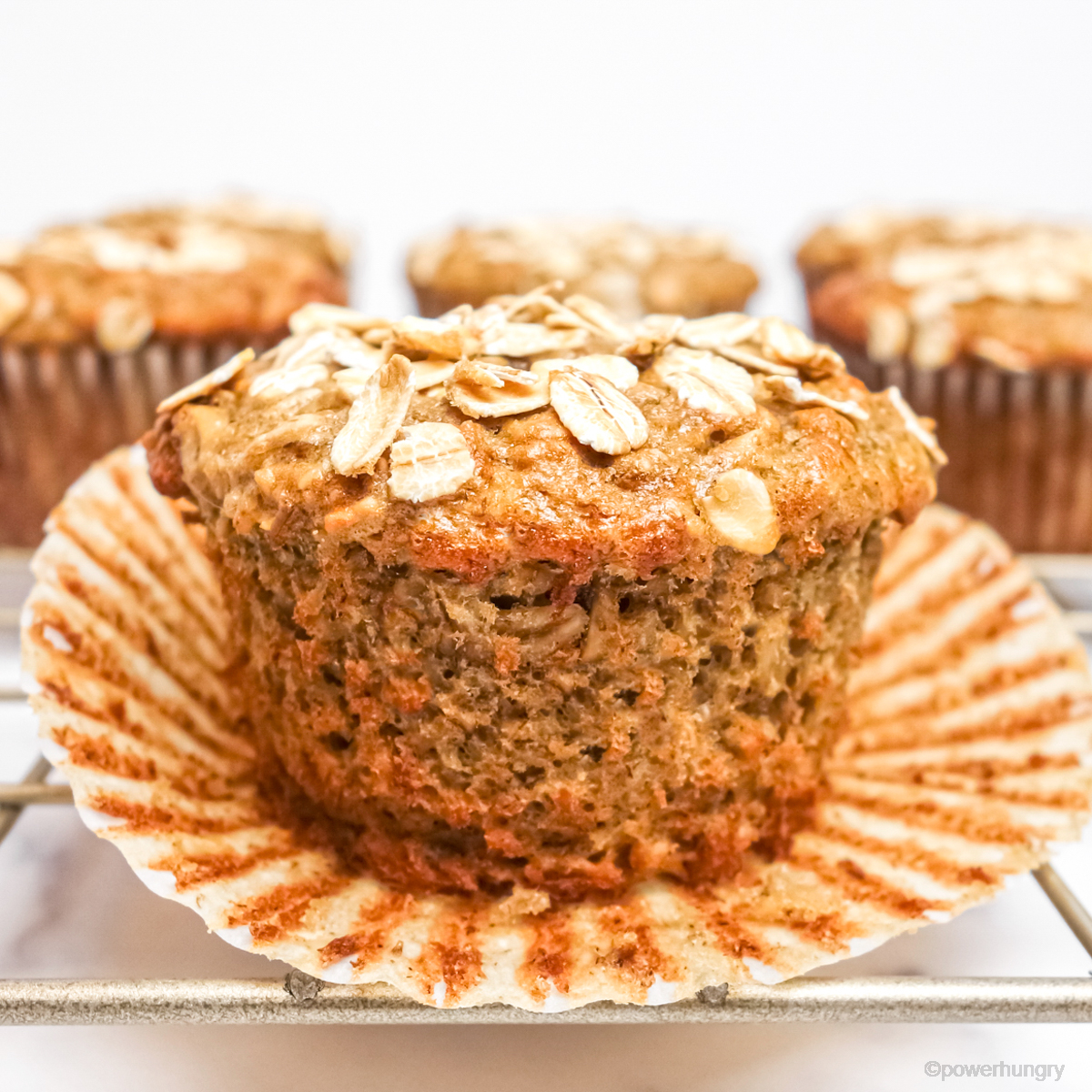 banana oat muffin with the paper removed part way