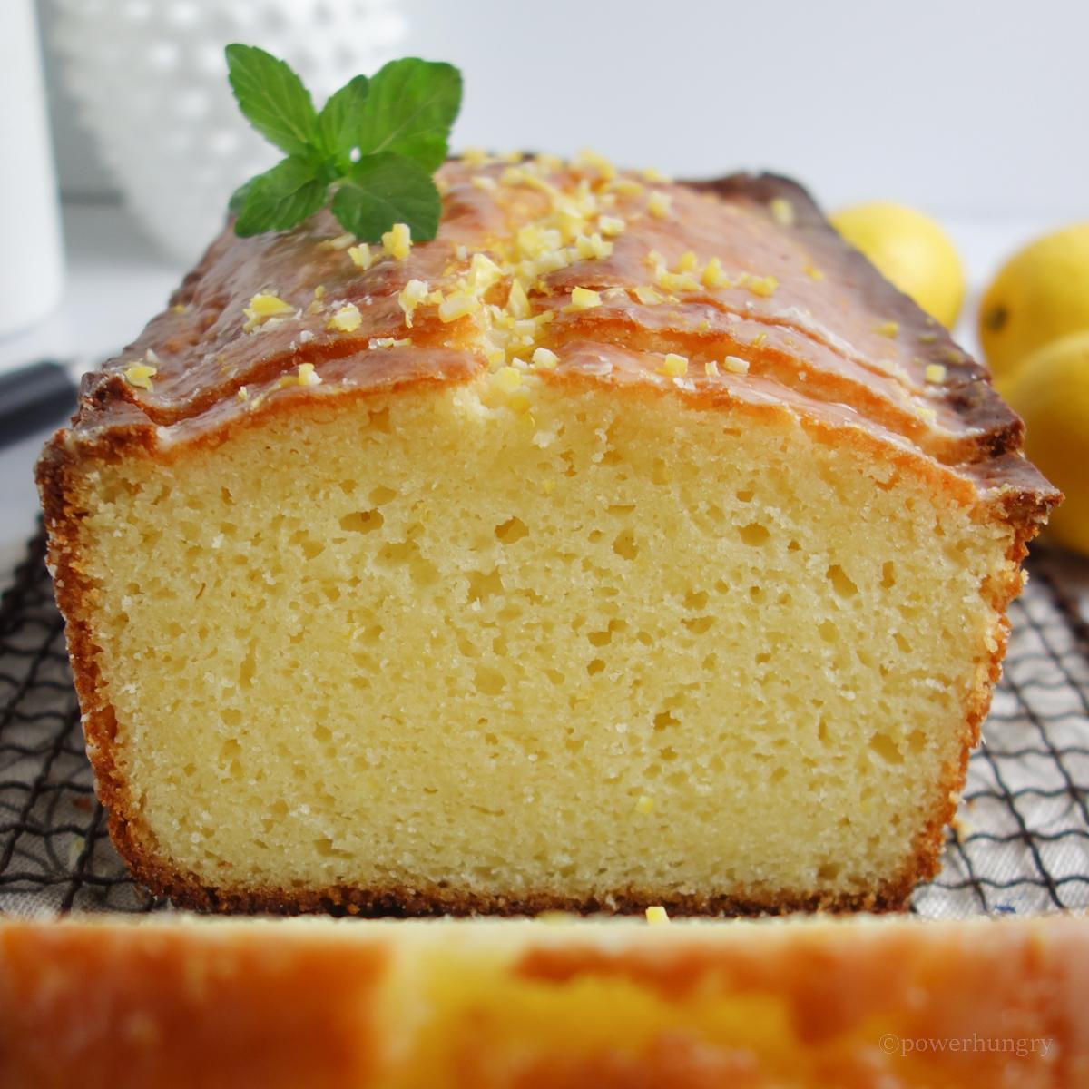 close up of a sliced lemon loaf on a cooling rack