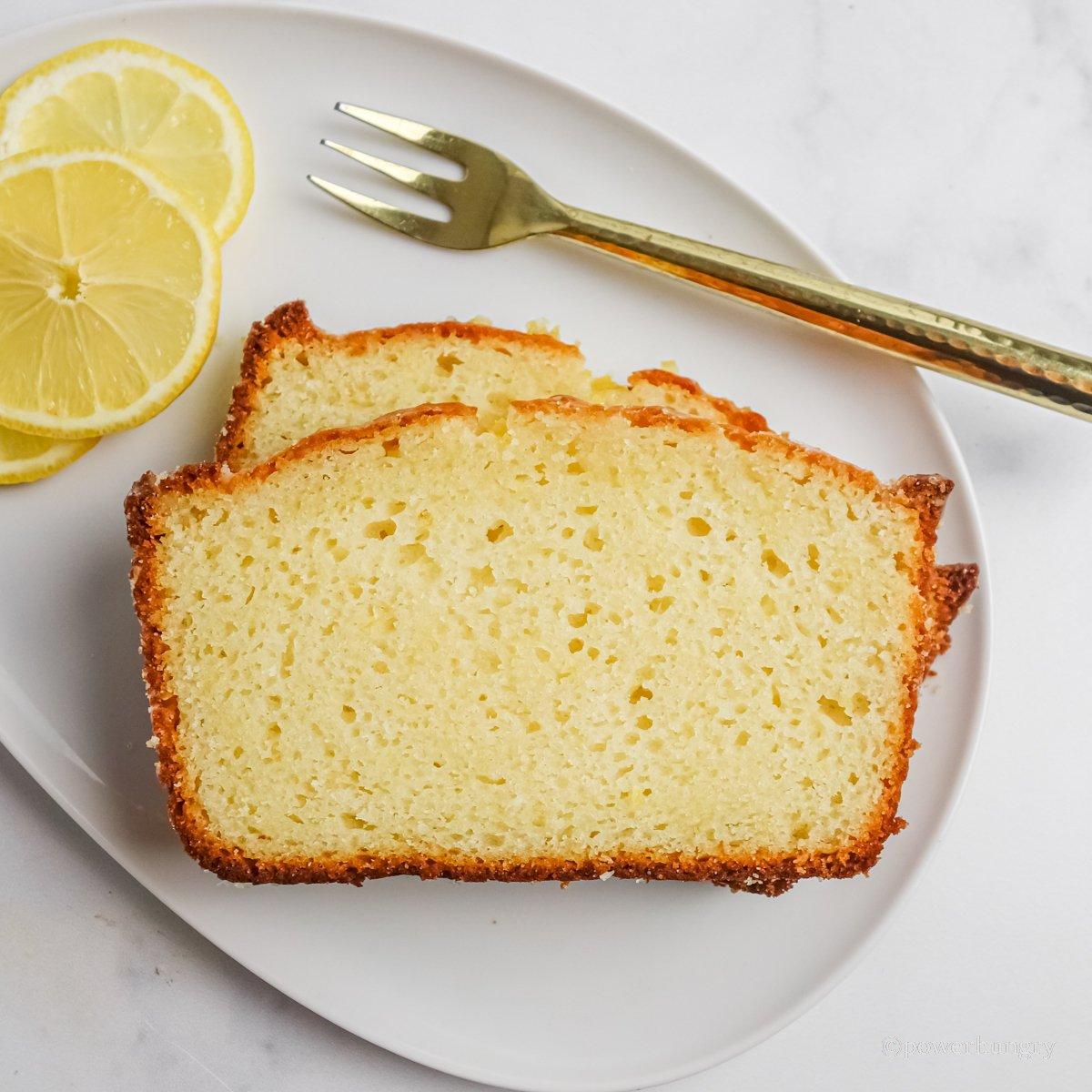 overhead shot of slices of grain-free vegan lemon bread on a white plate