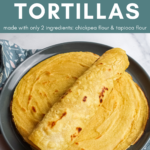 Stack of grain free vegan tortillas on a gray plate. The top tortilla is rolled up.