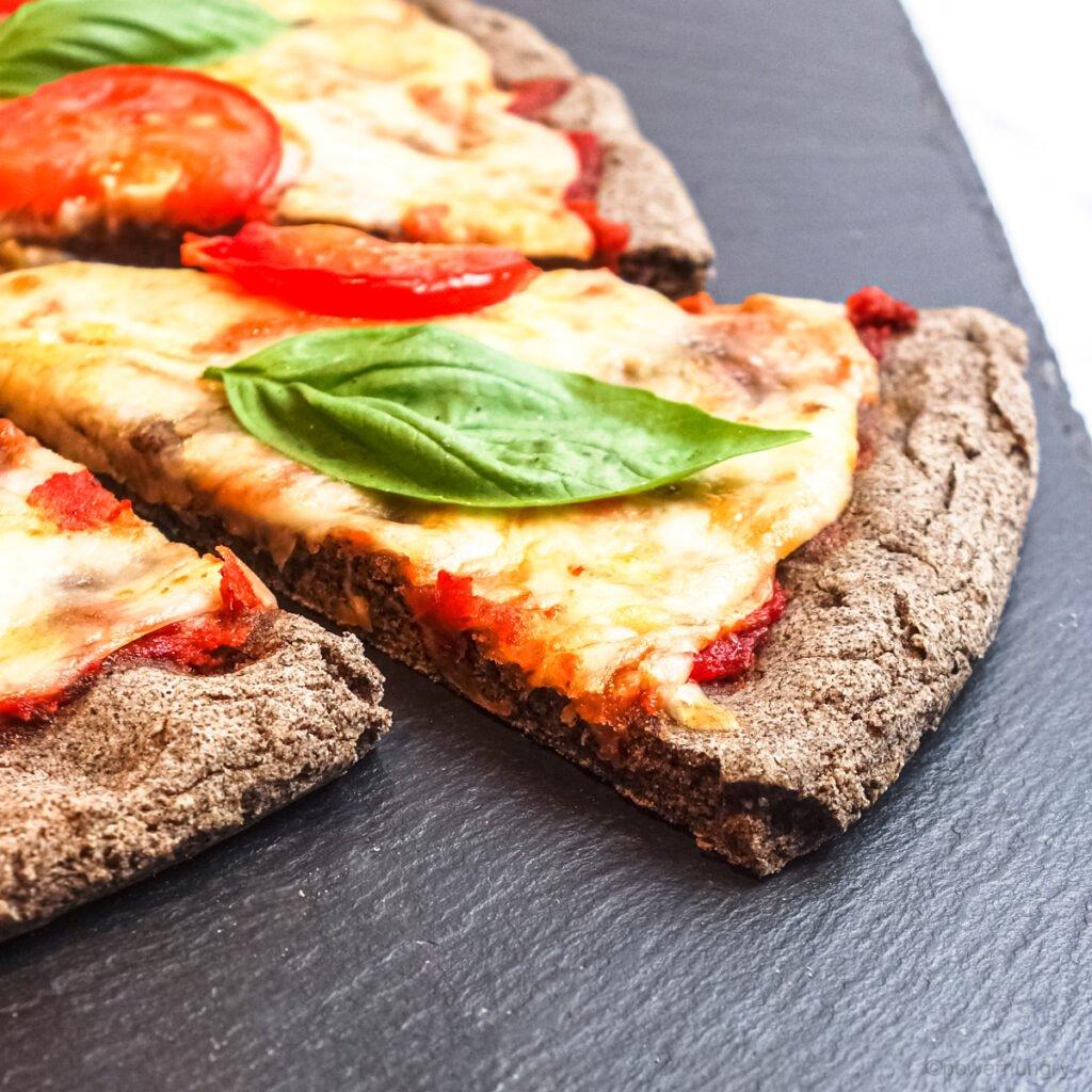 close-up of the crust edge of an easy buckwheat flour pizza crust